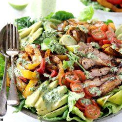 Keto Low Carb Chicken Fajita Salad - My PCOS Kitchen - A fajita salad with grilled chicken and veggies with a creamy cilantro dressing.
