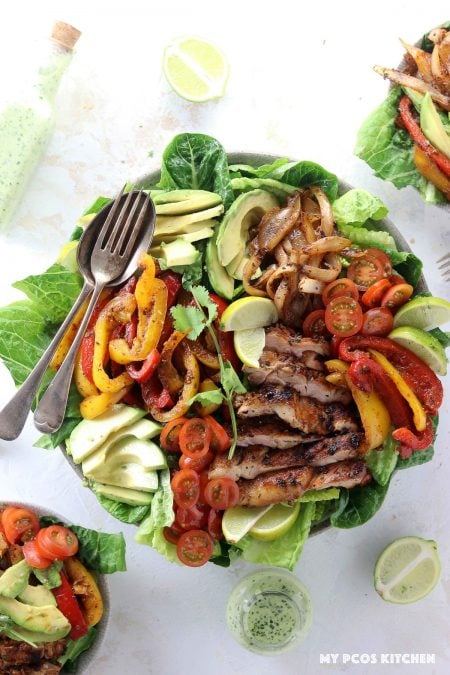 Keto Low Carb Chicken Fajita Salad - My PCOS Kitchen -  Delicious homemade chicken fajita with homemade marinade over a bed of romaine lettuce.