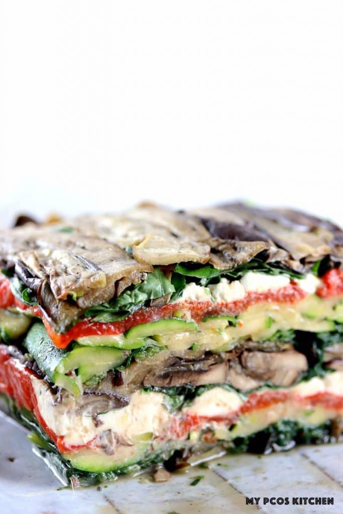 My PCOS Kitchen - Roasted Vegetable Terrine - Grilled vegetable stack perfect for a ketogenic or primal diet! Grilled zucchinis, eggplants, roasted red peppers, spinach, mushrooms and goat cheese.