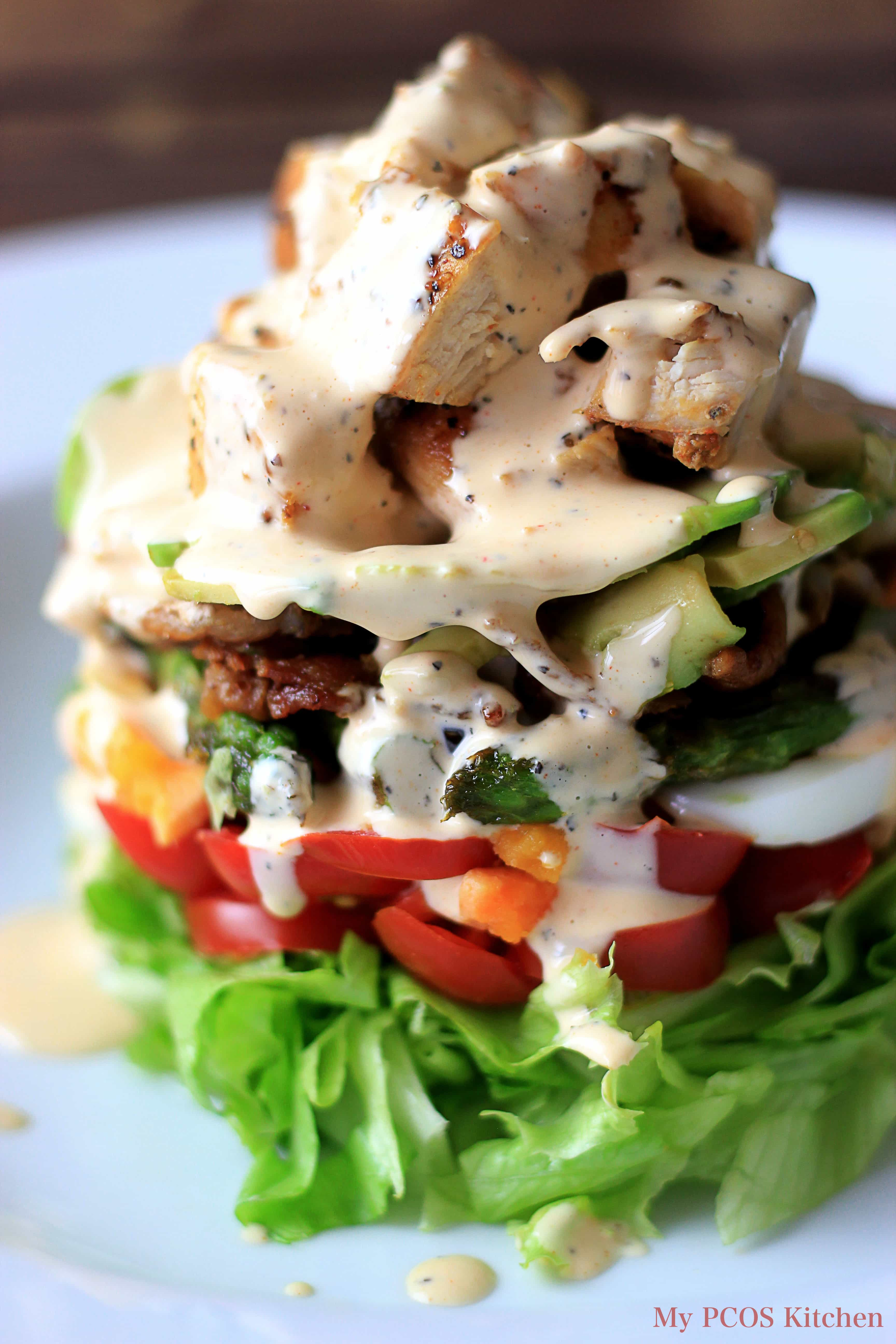 Paleo Cobb Salad with a Buffalo Ranch Dressing. The salad is low carb, low calorie, gluten-free and dairy-free. LCHF.