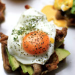 Paleo Avocado & Bacon Waffle Toast with a Sunny Side Up Egg. Paleo, gluten-free waffles perfect for a low-carb diet!