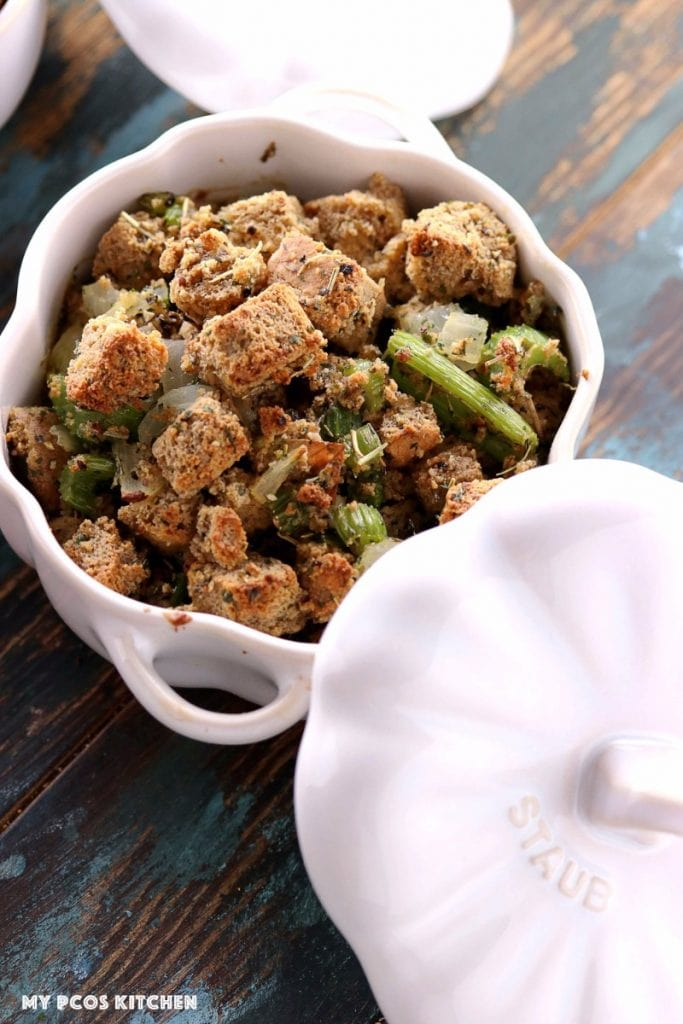 My PCOS Kitchen - Low Carb Stuffing with Sausage - An overhead shot of gluten-free paleo stuffing in a staub white pumpkin ramekin.