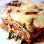 Low Carb Zucchini Lasagna - My PCOS Kitchen - A closeup shot of the zucchini noodles lasagna sheets. Meaty tomato sauce with cheese.
