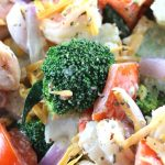 Amish Broccoli Cauliflower Salad with Shrimps - My PCOS Kitchen - A closeup shot of broccoli and cauliflower salad with tomatoes, red onions and cheddar.