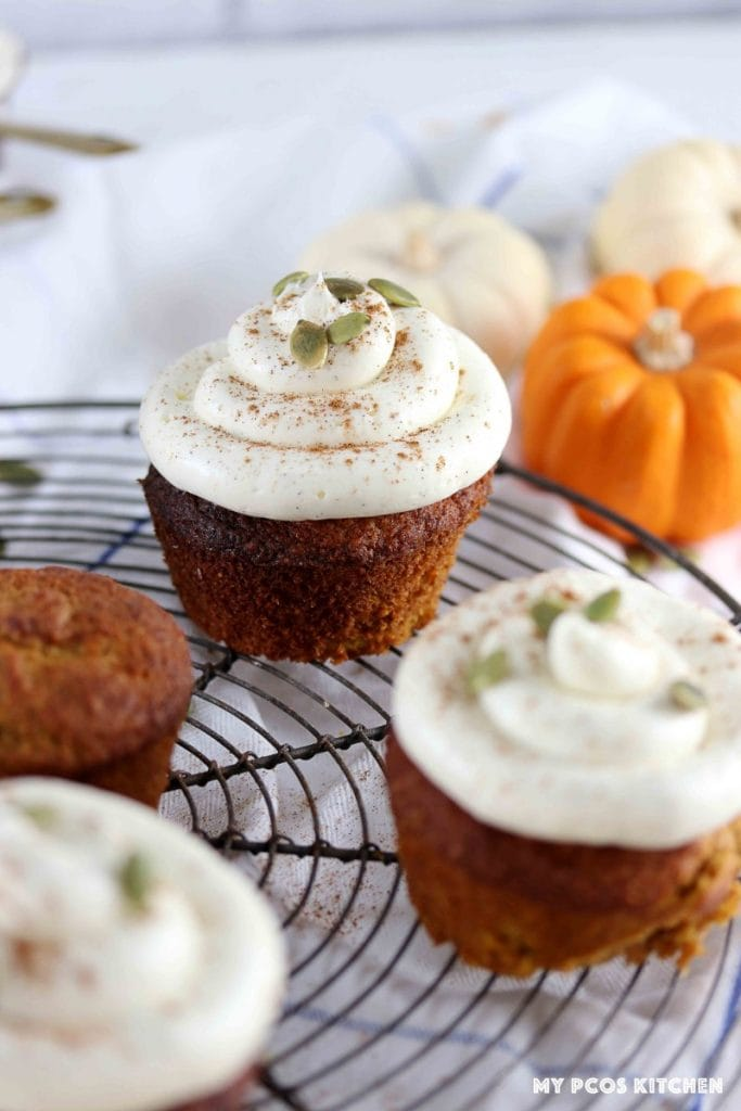 Low carb pumpkin spiced cupcakes on a cooling rack.